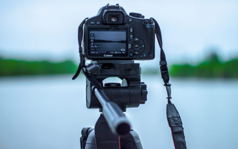 selective-focus-photo-of-black-canon-camera-on-tripod-stand-1089030